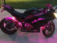 Pink Ninja 300 woman's motorcycle