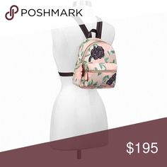"COACH Floral Mini Backpack Perfect for traveling, a day trip or a hands free shopping day!  COACH MINI CHARLIE BACKPACK WITH CAMO ROSE FLORAL PRINT  Printed coated canvas Inside zip and multifunction pockets Zip closure, fabric lining Top handle with 2"" drop Outside zip pocket Adjustable shoulder straps 7 1/2"" (L) x 9 1/4"" (H) x 3 3/4"" (W) Coach Bags Backpacks"