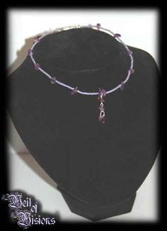 Elegant handmade necklace of lilac beads and amethyst stones. £9