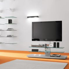 Cattelan Italia Panorama TV Unit - TV unit on wheels, adjustable in height, with cable cover. Stainless steel structure and clear glass shelves. System Furniture, Tv Furniture, Italian Furniture, Furniture Design, Furniture Showroom, Modern Furniture, Service Design, Tv Holder, Tv Regal