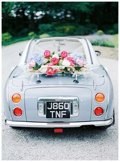 Style your wedding car with some bright florals | Woodlands Hotel Leeds Wedding | www.clare-robinson.co.uk