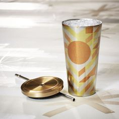 An insulated, stainless steel Cold Cup tumbler featuring a gold and yellow chevron design. Part of our Dot Collection.