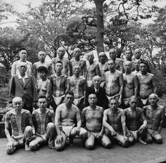 Mid 20th century, Japan ~ A group of traditionally tattooed gamblers. Umezu (c), the chief of gambling, sits among them.
