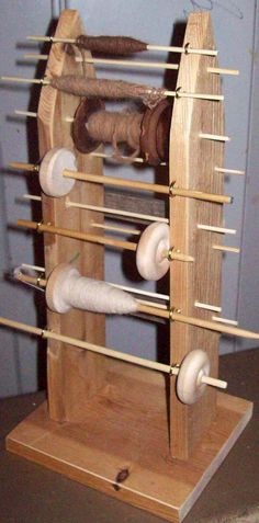 DIY drop spindle lazy kate - could be modified for bobbins...