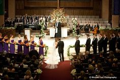 Gorgeous ceremony decor - large altar arrangement and lush flowers and candles on the altar railing / www.keelythorne.com / Michael Carr Photography