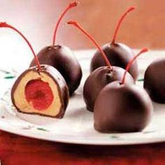Cherry Peanut Butter Balls Recipe -Years ago, I saved this festive recipe and made it only at Christmastime. But my grandkids loved the sweet combination of peanut butter, chocolate and cherries so much that now I mix up a batch anytime they ask or visit! Yummy Treats, Delicious Desserts, Sweet Treats, Yummy Food, Candy Recipes, Dessert Recipes, Butterball Recipe, Chocolates, Melting Chocolate Chips