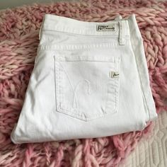 """Citizens of Humanity White Bootcut Jeans Citizens of Humanity kelly #001 stretch low waist Bootcut jeans. Have been hemmed to a frame of about 5'3"""" - 5'4"""" but could be let out at least 1/2 an inch. Citizens of Humanity Jeans Boot Cut"""