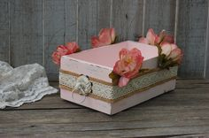 Upcycled vintage drawer hand painted in soft pink and embellished with silk cabbage roses, lace and burlap with an iron drawer pull, finished with a protective clear coat. This wood box has many uses