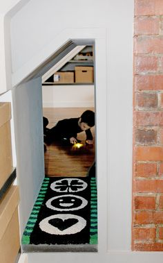 Mini rug in the crawl space is a custom design by Molly.