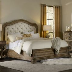 Rustic bed with diamond-tufted headboard.
