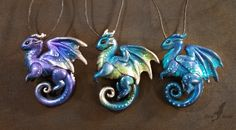 {~~Polymer clay dragon pendants~~} by AlviaAlcedo on DeviantArt Polymer Clay Dragon, Polymer Clay Crafts, Dragon Crafts, Dragon Art, Fantasy Dragon, Polymer Clay Pendant, Polymer Clay Jewelry, Dragon Figurines, Dragon Jewelry