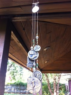 Grown children's sports medals turned into a windchime.