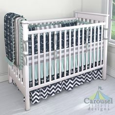 Crib bedding in White and Gray Stripe, Navy Anchors, Solid Seafoam Aqua, Solid Cloud Gray, White and Navy Zig Zag. Created using the Nursery Designer® by Carousel Designs where you mix and match from hundreds of fabrics to create your own unique baby bedding. #carouseldesigns