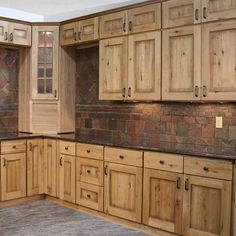 Perfect cabinets, just build them in and keep top shelves open. Lighter grey or blue glass backsplash, white countertop, grey hardwood. And take out that corner nook.