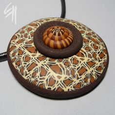 Polymer clay jewellery - pendant. I love using this shell-like piece and I use it a lot.