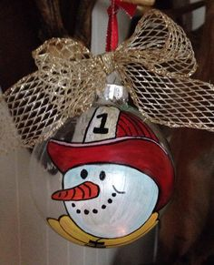 Fireman snowman on glass by Diane Cash. Painted Christmas Ornaments, Christmas Decorations To Make, Christmas Rock, Christmas Bulbs, Merry Christmas, Christmas Projects, Holiday Crafts, Christmas Ideas, Winter Wonderland