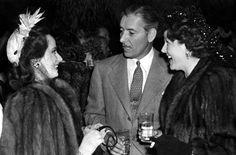 Merle Oberon, Ronald Colman and Benita Hume at a party. November, 1948