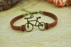 Bronze bike charm braceletRetro brown leather by Richardwu on Etsy, $1.50