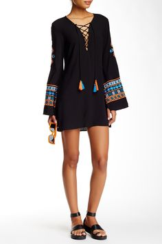 Festival ready!  Love this re:named apparel black lace up embroidered dress