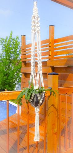 This piece of art is a real trendy find that will suspend your favorite greenery with style! Its a chic twist to traditional macrame who embellished