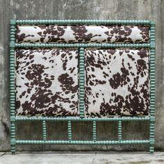 Turquoise + cow print headboard.