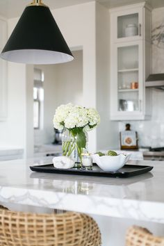 BECKI OWENS- Estillo Project: Classic Modern Kitchen. Kitchen styling in a white kitchen with statuary marble.