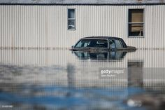 A residence is inundated with floodwaters from the Lumber River on October 11, 2016 in Fair Bluff, North Carolina. Thousands of homes have been damaged in North Carolina as a result of Hurricane Matthew and many are still under threat of flooding.
