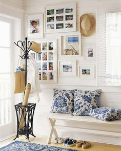 white picture frames, iron stand, wooden bench, straw accessories, blue & white.