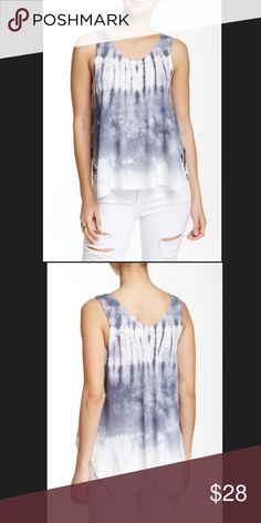 "Soprano – Side Slit Open Tank. Soprano – Side Slit Open Tank.                                           Details A scooped and sleeveless top is cut into a hi-lo profile from blended knit and finished with tie dye print. - Scoop neck - Sleeveless - Size : M Armpit to Armpit 21"" Approx Length 24"" - Made in USA Soprano  Tops Tank Tops"