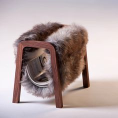 Magazine Rack. Originally inspired by the form of the Herdwick sheep, this quirky magazine rack makes a charming addition to any living room.  Constructed using bridal joints, this luxury accessory remains both elegant and robust and reveals the natural beauty of both sides of the sheepskin.  Made in Oxfordshire using sheepskin that's produced in the UK and tanned in Devon, this truly is a British product. £199 #home #gift #ideas #unique