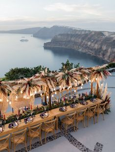 Cliffside Winery Wedding in Santorini with Romantic Pampas Grass Decor - Green Wedding Shoes