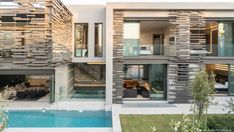 "The light-filled unique and eco-friendly home was designed by Nico van der Meulen Architects, located in Inanda, a township in eastern KwaZulu-Natal, South Africa. ""Forest Road Home"" is… Atrium, House Wall Design, House Plans South Africa, Cabin Style Homes, Contemporary Cabin, Forest Road, Eco Friendly House, Pool Houses, Lanai"