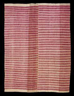 Yoruba, circa 1900. Beige wild silk ground, open work, weft floats of magenta silk. UK private collection.