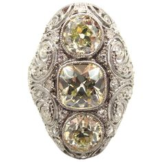 Exquisite Edwardian Era Platinum & 3-Stone Diamond Navette Engagement Ring | From a unique collection of vintage engagement rings at http://www.1stdibs.com/jewelry/rings/engagement-rings/