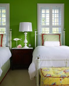 Granny Smith Apple green walls paint color, Williams-Sonoma Home Hampstead Nightstand, white lamp, matching twin white headboards, green striped shams with red trim, green bedskirts with red ribbon trim, yellow tufted ottomans.