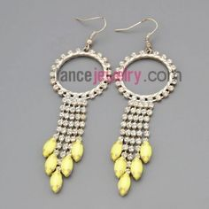 Striking earrings with claw chain rings decorate many rhinestone and light yellow pendant