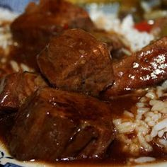 Crockpot Beef Tips and Rice - Braising beef, cut into meaty chunks, slow cooked in a well seasoned gravy and served over rice or egg noodles- Deep South Dish Crock Pot Beef Tips, Crock Pot Slow Cooker, Crock Pot Cooking, Crockpot Recipes, Crockpot Dishes, Steak Recipes, Cooking Beef, Cooking Pasta, Cajun Recipes