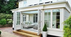 orangery kitchen extension | Orangery system with feature bi folding doors