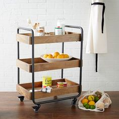 Wood Kitchen Caddy #westelm used this as an entryway table in a single dad's cabin. Rocks.