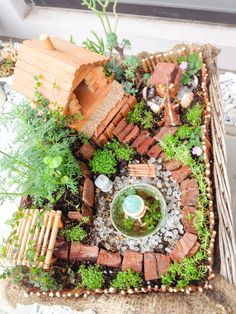 My mini log house landscape will invite fairies to stay.
