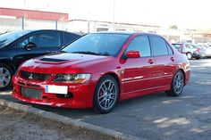 Just a Stock Evo IX in Rally Red