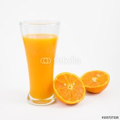 """Download the royalty-free photo """"The glass of tasty pure orange juice and fresh orange half for a good healthy."""" created by phasuthorn at the lowest price on Fotolia.com. Browse our cheap image bank online to find the perfect stock photo for your marketing projects!"""