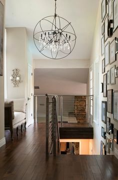 Creative Foyer Chandelier Ideas for Your Living Room  23 pics Interiordesignshome.com A black glass foyer chandelier hangs from a warm silver leaved dome