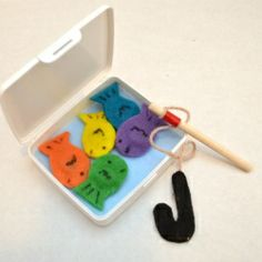 "Tell your little Valentine that he or she is a ""great catch"" with this fun and easy magnetic travel fishing game!"
