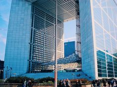 Have you ever realized how this holed cube in the centre of #Paris  is big? It's a building of La Defence and you finally have the comparison how this mega building is so freaking huge with humans standing near side