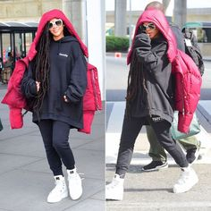 Rihanna Chen Peng red puffer jacket, Vetements embroidered black hoodie, Trapstar black side panel sweatpants, Fenty x Puma white platform sneaker boots, Gucci square crystal sunglasses