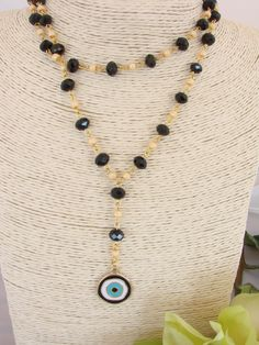 Greek Gold Tone Black Tear Drop Evil Eye  Necklace by ForThatSpecialDay on Etsy