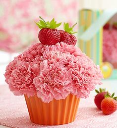 Cupcake in Bloom™ Strawberry    Price:  US$25.99    All of the fun, none of the calories. That's our hip, hand-designed cupcake-shaped arrangement of frilly pink carnations in a ceramic cupcake cup. The icing on the cake -- a pair of realistic strawberry picks that make this a sweet surprise for any occasion.