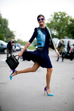 Oh Snap! The Street Style Moments That Totally Made Our Year: High-wattage lace-up heels and a heavy-on-the-hardware leather jacket added a tough-girl counter to pretty prints.: Giovanna Battaglia's look kind of makes us want to jump for joy too.