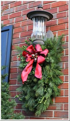 DIY: Christmas Porch Light Decoration - - How to Make and Decorate with Holiday Greenery To Hang Over an Outdoor Light Christmas Greenery, Noel Christmas, Outdoor Christmas Decorations, Rustic Christmas, Christmas Projects, Winter Christmas, Light Decorations, Christmas Lights, Christmas Wreaths